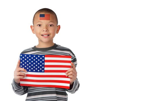A proud american boy displays an american flag on his forehead and in his hands.