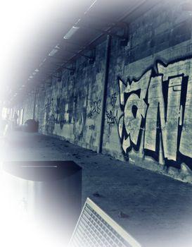Graffiti and street art at a train station wall.