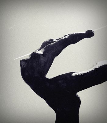 Erotic sculpture in gymnastic positioning. Monochrome photography.