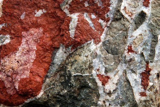 Milticolored stone granite texture. Combination of red and gray material