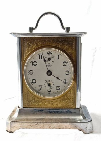 Really old rusty antique alarm clock