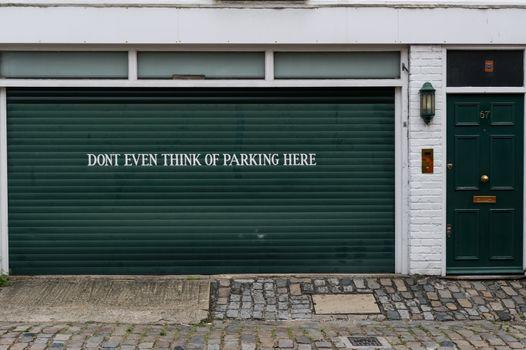 Garage sign prohibiting parking