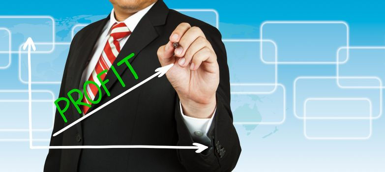 Businessman drawing a graph with Profit going up