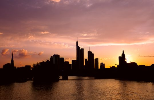 silhouettes of Frankfurt architecture over sunset