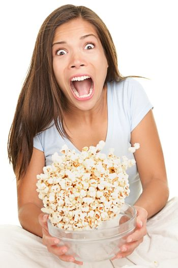 Woman scared funny watching movie