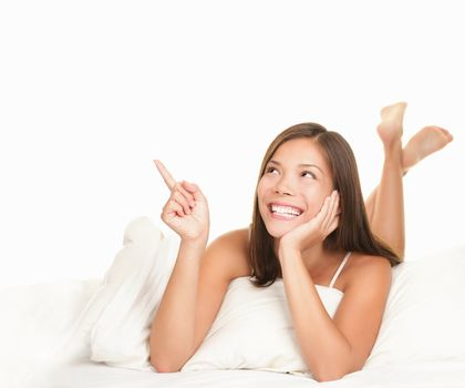 Bed woman pointing up