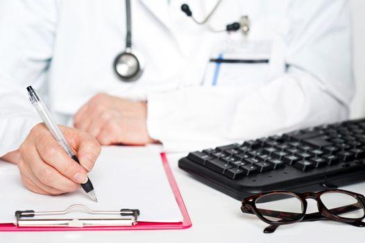 Closeup shot of female doctor writing prescription