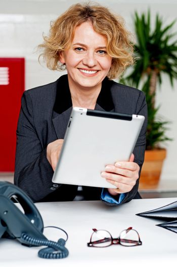 Cheerful businesswoman using portable tablet
