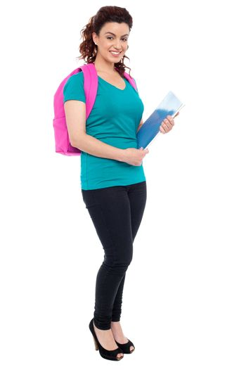 Student with backpack and spiral notebook