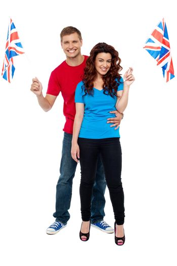 Guy hugging his girlfriend and both holding UK flag
