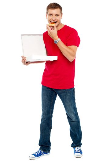 Causal  smart guy holding pizza box and eating a piece