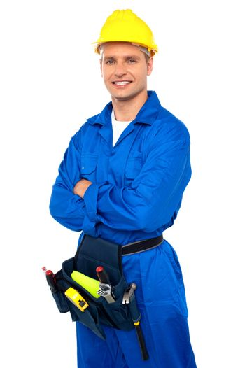 Young contractor with tool set and arms crossed