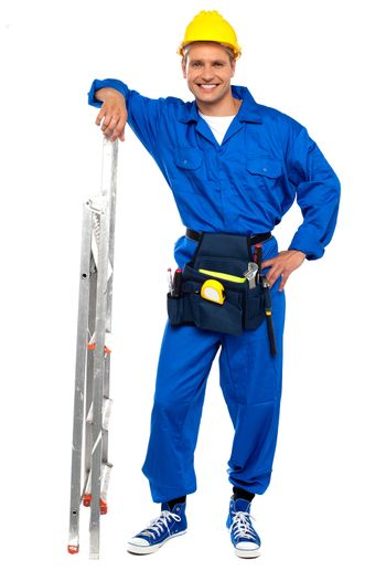 Industrial contractor resting hand on stepladder