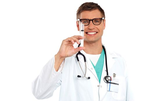 Doctor with an injection needle with white fluid