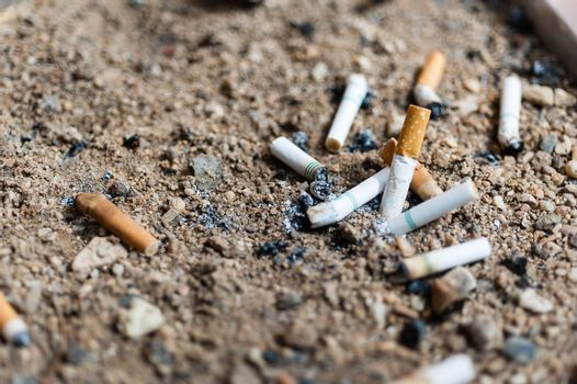 many cigarette butts in ashtray sand truck