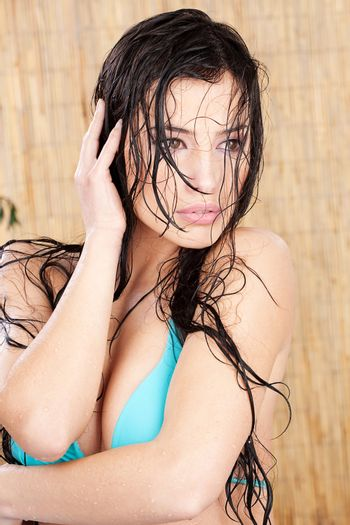 wet woman in tropical environment