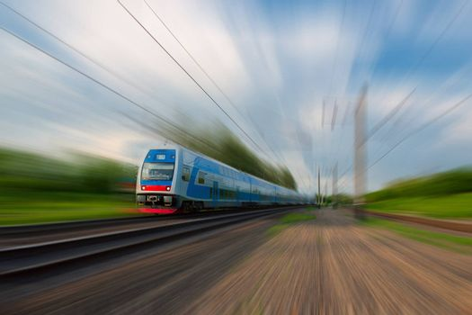 High-speed commuter train with motion blur