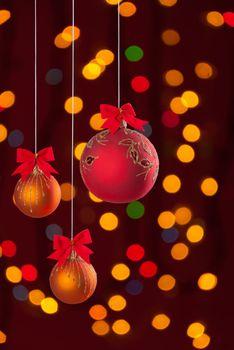 Christmas balls on ribbon on festive background
