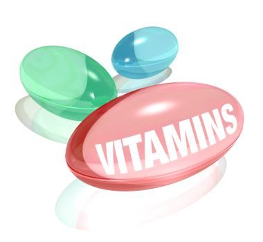 Three colorful vitamins - one red, green and blue - on a white background. Each vitamin in capsule pill form