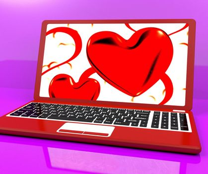 Red Hearts On Laptop Showing Love And Romance
