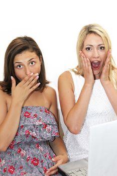 Two women reacting in shocked awe