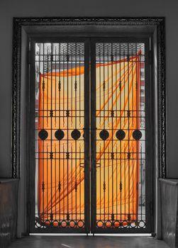 Orange Cloth of Monk hang with door of temple