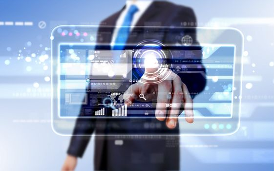 Businessman in blue suit working with digital vurtual screen
