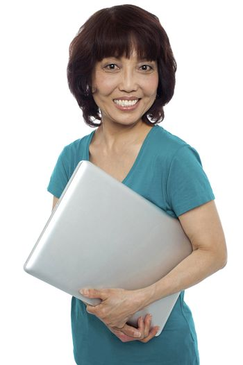 Casual woman carrying her laptop