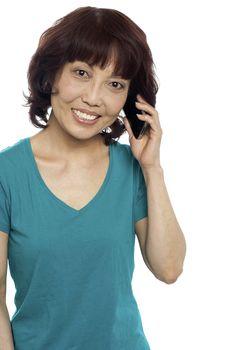 Pretty female communicating through cellphone
