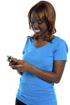 Girl sending message through her cellphone