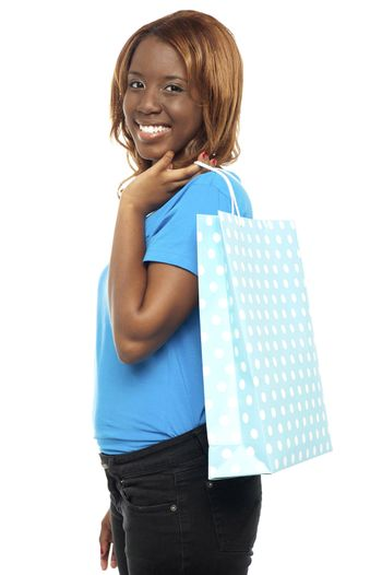 Satisfied lady shopper with shopping bag