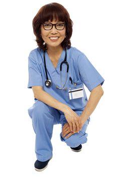 Female surgeon semi seated on floor. Studio shot