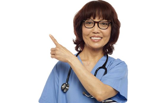 Nurse pointing at the copy space