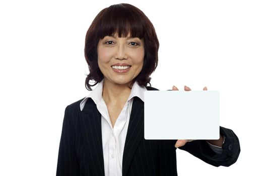 Business lady showing blank placard to camera