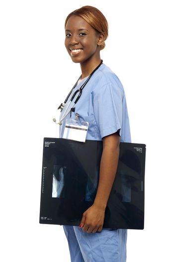 Nurse carrying x-ray reports to doctor