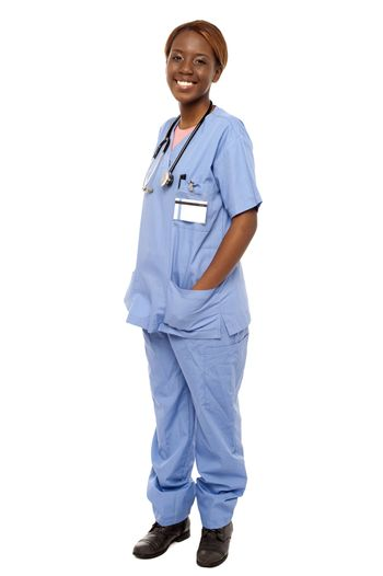 Medical expert posing with hands in her uniform