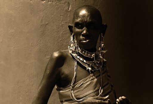 Portrait of an African lady that dressed traditionally, sepia toned