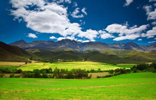 Image of South Africa landscape, mountains range and agricultural fields, beautiful summer nature, Garden Route park, wildlife safari, beauty of African continent, eco tourism and travel