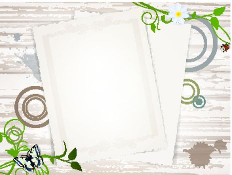 Vintage paper blank at wooden background over green leaves, copyspace