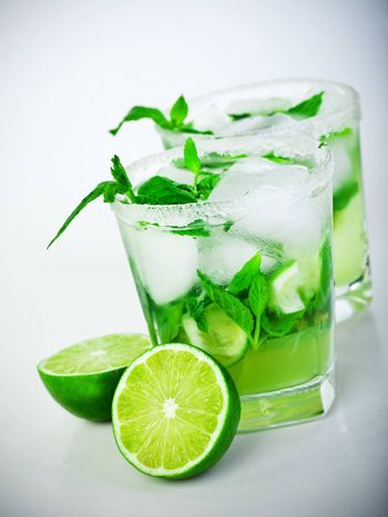 Cold mojito drink, glass of icy alcohol refreshing booze, tasty Cuban alcoholic cocktail made of fresh mint leaves and lime fruit, food and beverage still life, party and holidays celebration