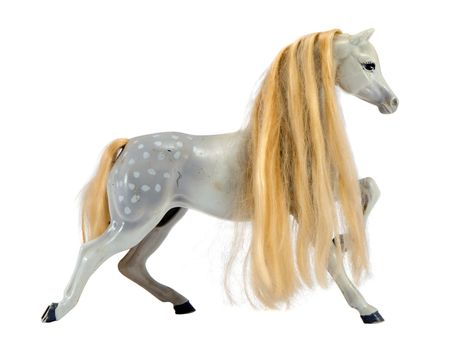 White statue figure of horse with long blonde mane isolated on white background. Nice toy decor.