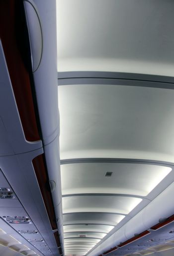 the modern ceiling in the aeroplane with lights