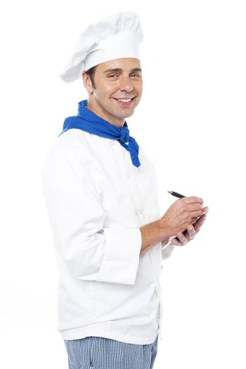 Chef taking down the order from customers