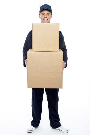 Young relocation staff member holding cardboard boxes