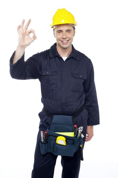 Senior repairman showing good work done sign
