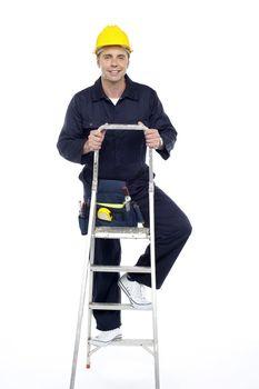 Its work time. Repairman climbing stepladder