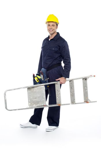 Repairman holding stepladder, ready to go to work