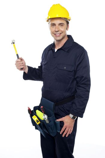 Repairman holding out hammer from his tool kit