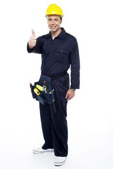 Industrial contractor gesturing thumbs up