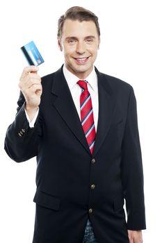 An entrepreneur showing debit card to camera